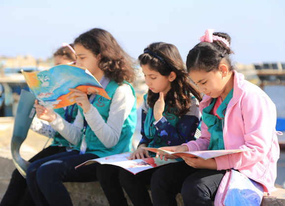 Girls reading in Gaza