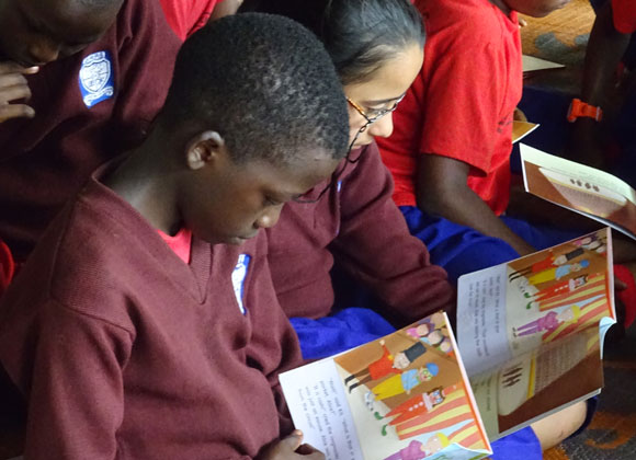 Reading books in a school in Uganda