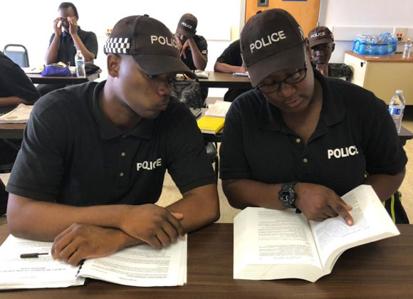 Police studying with books