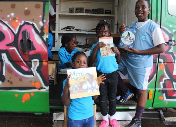 Kids showing the books they have chosen